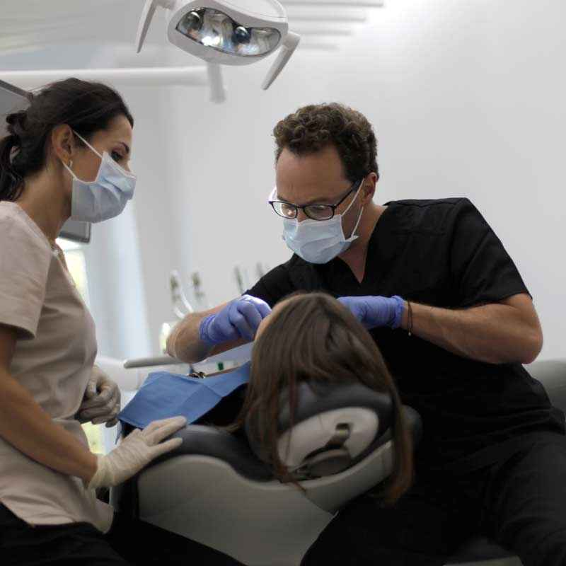 orthodontic session with a dentist and a dental assistant