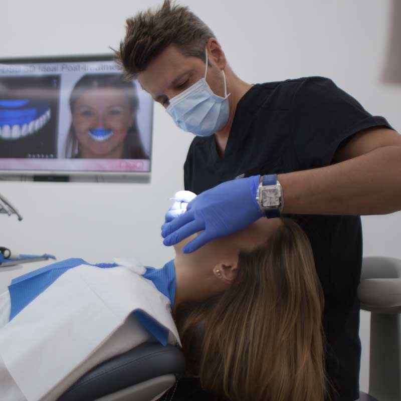 Dentist scanning the mouth of a patient